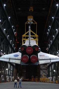 The Space Shuttle being hoisted to a vertical position to be mater to the external fuel tank.