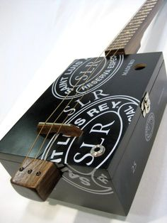 Saint Luis SLR Cigar Box Guitar 3 String Cigar Box  This is a nice lookin' guitar. Walnut all over this baby with some sweet Silver Grover Tuners.