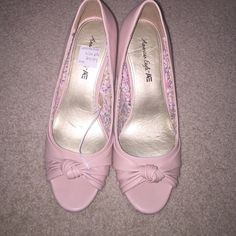 American Eagle pink heels Size 6.5. In new condition; have not worn these out before! Fits for those that are size 6. American Eagle by Payless Shoes Heels