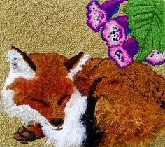 Fox sleeping in Foxglove
