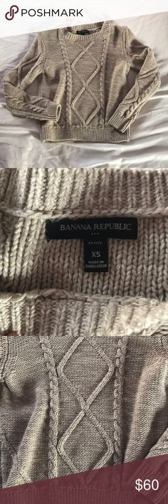 Banana Republic Cropped Sweater Thick sweater to keep you warm in the winter. Cropped, so would look great with high waisted jeans or a skirt. Heathered beige with white and is in perfect condition. Banana Republic Sweaters