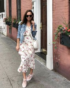 A floral dress and sneakers with a denim jacket in the city  #ShopStyle #shopthelook #SpringStyle #MyShopStyle #SummerStyle #TravelOutfit #OOTD