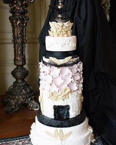 Perfection lies on each and every tier of this glamorous wedding cake by @innickadeecakes. Loving the neoclassical style with black, gold, baby pink and white color combination, especially those gold leaf and intricate cupid sugar art that adds a lavish look on this cake. Who would love to have this as their wedding cake? Tag a friend who would!