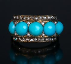 An Antique Victorian Turquoise Rose Cut Diamond Gold Ring circa 1860 Five-stone turquoise 14K gold ring is accented with numerous rose cut diamonds. Width