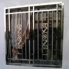 Window grills design interior window grills multidao for Window design tamilnadu