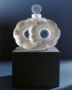 "'Lalique ""Two Flowers"" Perfume Bottle'  Designed by ~Renee Lalique~ [1935. This petite perfume bottle featuring two flowers in bloom is a sensual blend of frosted and smooth glass complemented by delicately formed, fluid lines. Handcrafted of crystal.  3.75 inches tall.  Holds 1.6 ounces.  Made in France.]"