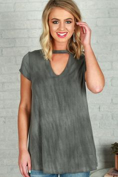 Stay casual + chic in this cut out cutie! This flowy tee is perfectly paired with your fave distressed denim and some fun sandals!