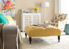 Inspiration for bland apartment living room? Use the neutral walls/carpet and punches of color on accent pieces