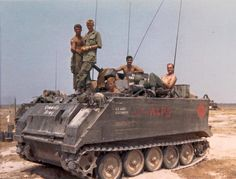 An M113 Armored Personnel Carrier most likely attached to the 5th Infantry Division, judging by the distinctive red diamond painted onto the side of the armor.