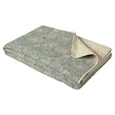 A lightweight cotton quilt that features a pretty floral pattern on one side and a smart stripe on the other, both in blue/grey on a cream background. It will work beautifully as a bed cover and provide valuable extra warmth on cold winter nights. 100% cotton. Reversible. Machine washable.