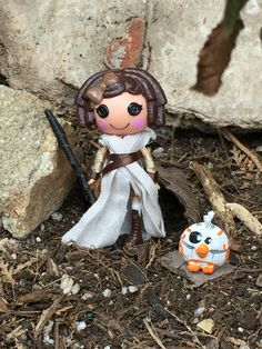 This is my custom Lalaloopsy mini Star Wars the Force Awakens Rey doll. I also painted a pet parrot from another Lalaloopsy doll to look like BB8. The force is strong with this one.
