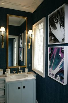 Bold inky blue walls make for a dramatic powder room.