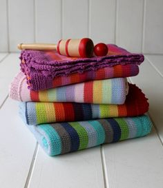 hand knitted stripey cot blanket by posh totty designs interiors   notonthehighstreet.com