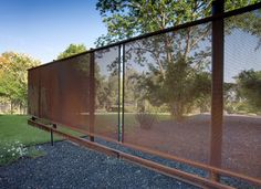 Oxidized industrial wire mesh as a landscape wall - could be beautiful.    Portfolio - modern - Landscape - Austin - D-CRAIN Design and Construction