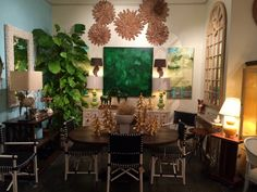 #love the #Green and #Gold in this new vignette in #Houston #diningroom #diningtable #miirrir #art #designidea #lamp #Lighting #interiordesign #decor