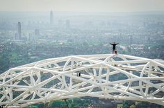 The 24-year-old stuntman stands with his arms outstretched on top the Wembley arch with th...