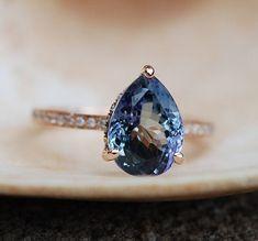 Tanzanite ring. Rose gold engagement ring. Eidelprecious ring. This Tanzanite is natural certified pear cut stone. The cut is mesmerizing, making