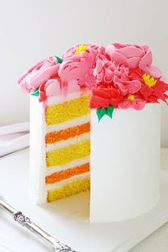 Spring Layer Cake with Pink Buttercream Flowers ~ http://iambaker.net