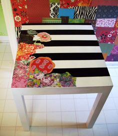 Decoupage table. Cool idea. I think I'd stick with one color flowers.