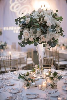 Villa Woodbine, Miami, Florida wedding. Lush formal wedding with greenery. Tall rose and hydrangea centerpiece. Green and white wedding.