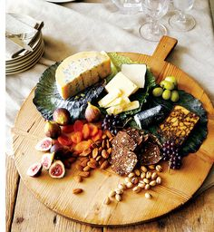 Figs - A cheese plate should include a blue cheese, a firm cheese such as cheddar, and a creamy one such as brie. Nuts, fresh and dried fruits, and bread or crackers complete it. Wine And Cheese Party, Wine Cheese, Cheese Fruit, Vegan Cheese, Potato Bites, Tasty, Yummy Food, Cheese Platters, Party Platters