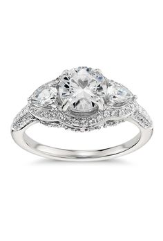 """Brides.com: Unique Engagement Ring Settings """"Charlotte"""" platinum and diamond engagement ring, $17,000 (setting only), Erica CourtneyPhoto: Courtesy of Erica Courtney"""