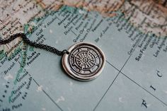 a silver wax seal compass travel necklace A Darker Shade Of Magic, 14k Gold Necklace, Silver Earrings, Black Sails, Wanderlust, Birthday Gifts For Her, How To Train Your Dragon, Wax Seals, Compass