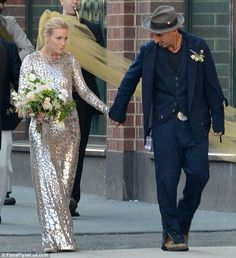 Hand in hand: Piper and Stephen head to their wedding reception on Saturday...