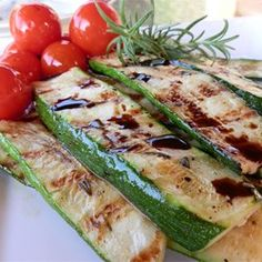 Grilled zucchini slices get a savory, garlic and Parmesan cheese topping for a quick, savory side dish.