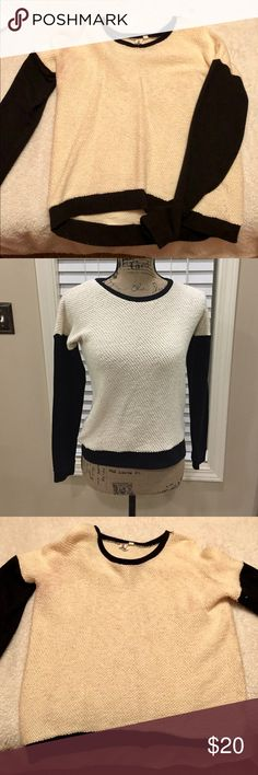 VANS Black and White Sweater This two tone sweater is the perfect dressed up skater look. Soft knitted sweater with black arms and creme body. Black and creme color.  Perfect with Jeans and boots in the winter  And Shorts in the summer! Gently worn *The picture of the sweater on the mannequin is not this exact item but used to show details. I love reasonable offers  Vans Sweaters Crew & Scoop Necks