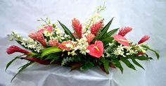 Long & Low Pink Tropical Arrangement   $137.50  This product is available for Maui delivery or Pick Up only. Please call 808-661-3455 Tropical Flower Arrangements, Table Flower Arrangements, Table Flowers, Tropical Flowers, Flowers Garden, Colorful Flowers, Church Flowers, Funeral Flowers, Wedding Flowers