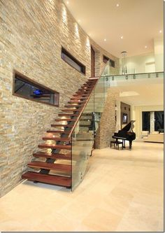 Stone veneer over the wall creates more unique look with variation of design and color. Stone veneer wall is quite interesting as additional feature at your home. Home Stairs Design, Home Room Design, Interior Stairs, Home Interior Design, House Design, Wall Design, Stone Wall Living Room, Living Rooms, Stacked Stone Walls