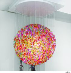'Candelier' by Jellio - made up entirely of thousands upon thousands of tiny acrylic gummi bears. About 5000 of them handstrung to catch the light just right, each Candelier is slightly different and takes about 2 months to put together.