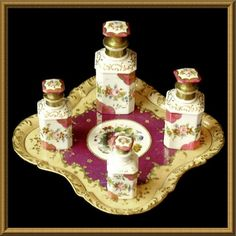 This very fine set of four Old Paris perfume bottles and tray feature