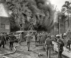 """Washington, D.C., or vicinity circa 1928. """"Photographing fire for newsreels."""""""