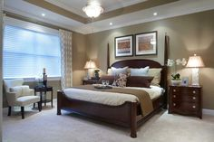 Great master bedroom: Wall color (with white molding), 4 post bed, reading area, bedding coloring