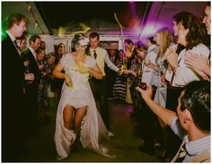 This was an EPIC original wedding first dance entrance.  No awkward shuffle for this couple, they had their favourite dance music on and in they came waving their glowsticks.  Brilliant #weddingdance #firstdance #festivalwedding Images by Lucabella. www.lucabella.co.uk