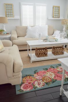 Decorating with white and neutrals creates a soft, calm place to add color and layer with texture. The Euro pillows I found at HomeGoods are XL and comfy, with a delicate gauzy ruffle. The glass hurricanes add great ambiance at night in this casual coastal cottage home. sponsored pin. See the rest of the home tour at www.foxhollowcottage.com