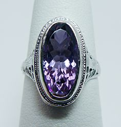 Beautiful Amethyst stone set in white gold filigree.