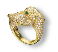 A DIAMOND AND EMERALD 'DOLPHIN' RING, BY CARTIER
