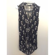 Flowy skull pattern knit top High low cut. Love it paired with black leggings and black undershirt. Tops
