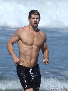 """Ryan Kwanten shows off his impressive physique as he takes a weekday dip in Malibu. The """"True Blood"""" star looked ripped as he frolicked along the shore in a pair of black swim trunks. Malibu, Ca August 5, 2014."""