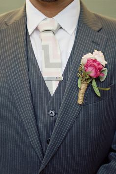 This rope-tied boutonniere looks so snazzy with the pink + gray tie and pin stripes. Photography by / untamedheartphotography.com, Floral design by / flowerstothepeople.biz
