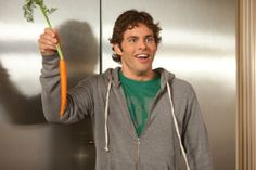 """A still from """"Hop,"""" and the man holding the carrot is James Marsden, the human star of this film."""