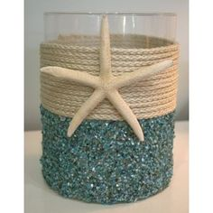 This costs $58 on this site but I bet I could recreate it for under $10... Aqua Seashell Coastal Candleholder - Extra Large