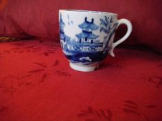 LOWESTOFT PORCELAIN COFFEE CUP BLUE / WHITE - HOUSES TREE FENCE PATTERN c1790  | eBay  SIZE - 7.0 cms high - 2 1/2 inch approx   WIDTH - 6.1 cms  - 2 3/8 inch.  PERFECT, EXCEPT FOR A CHIP IN THE FOOTRIM NEAR THE HANDLE £87