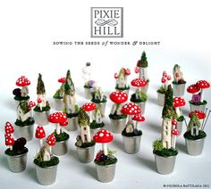 It's a faerie village full of spotted toadstools!  These were designed by Nichola Battilana (PixieHillStudio).
