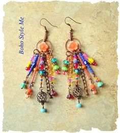These fun, playful e  These fun, playful earrings are perfect for today's boho style. I combined seven separate, colorful beaded dangles together, onto antique copper rings. Each beaded dangle is created with different colorful seed beads, Chevron beads, trade beads, lampwork beads, baby bell glass flowers, and copper charm beads. Swinging freely from the center are rustic matte orange glass flowers. Length – 4 inches, including copper ear wire.  Your purchases will be beautifully wr..