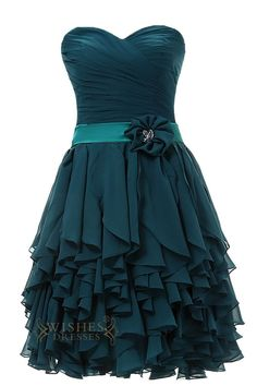 Ruched bodice with sweetheart neckline and chiffon multi-layer skirt while the…