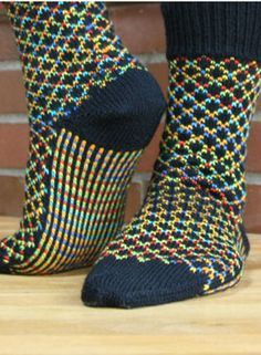 TicTac Toes Socks Pattern. I love the contrast of the variegated with black.